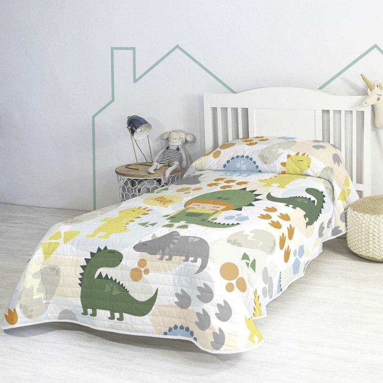 Cama infantil con edredón de dinosaurios